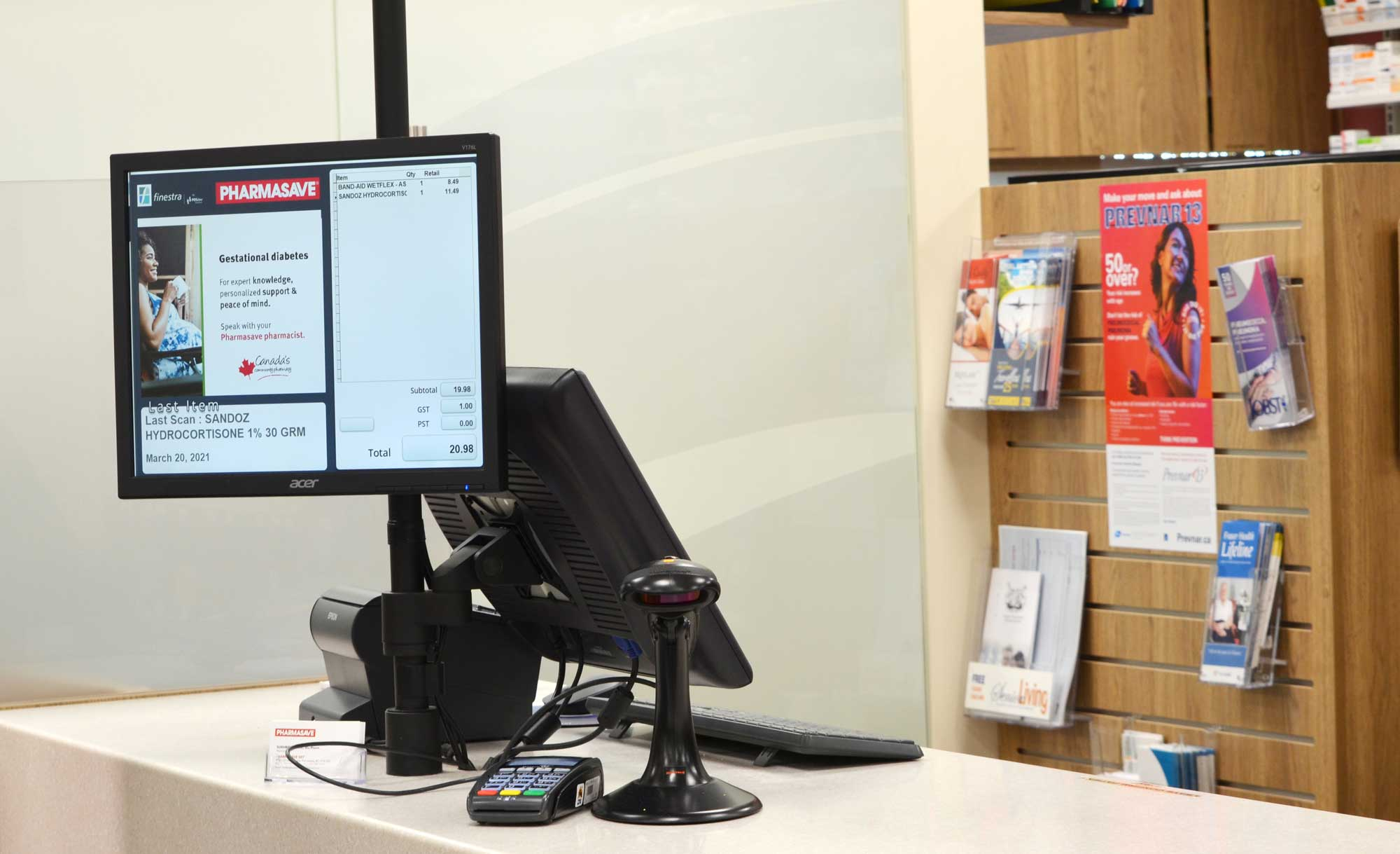 POS system sitting on a check out counter at a pharmasave pharmacy