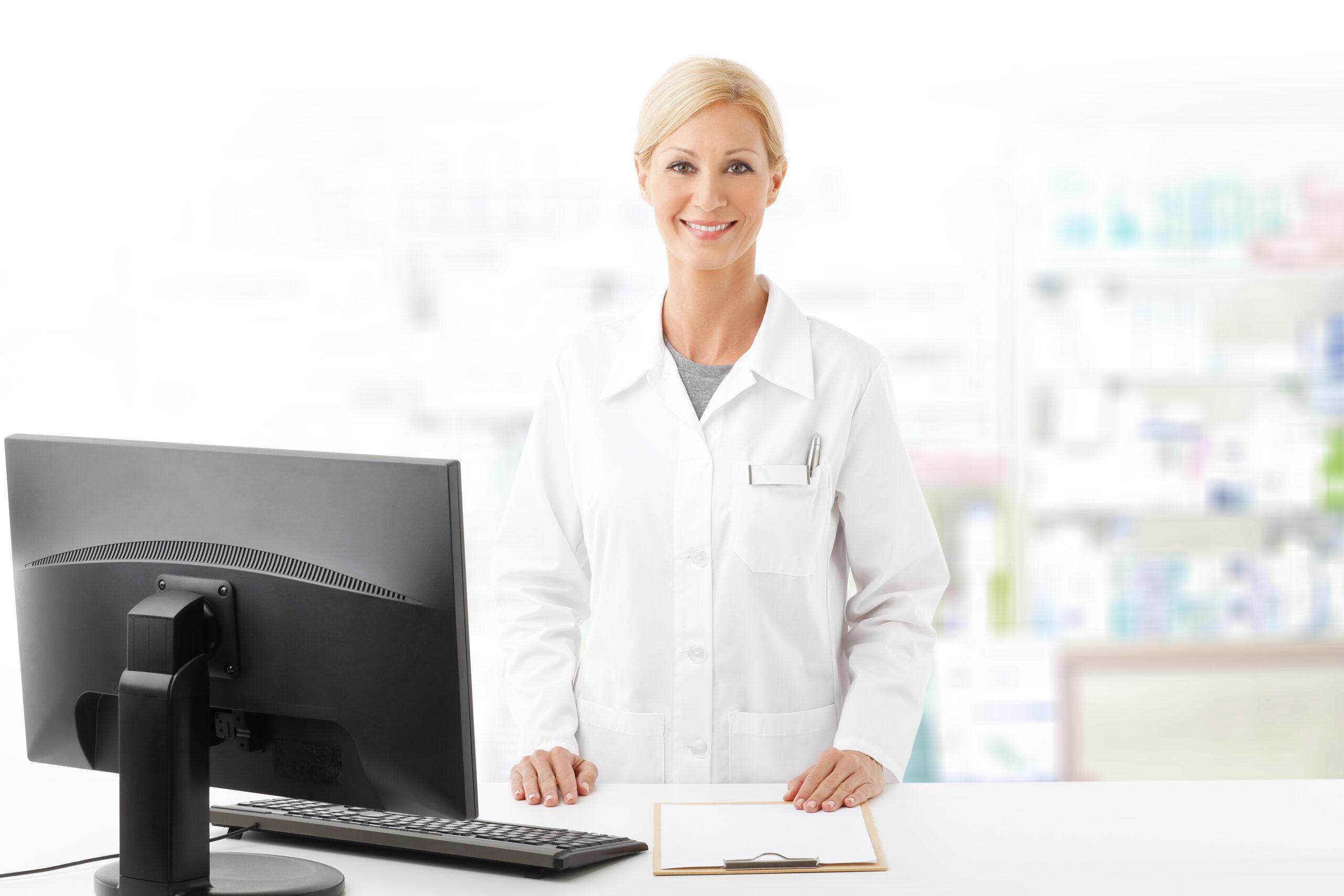 female pharmacy clerk at checkout smiling